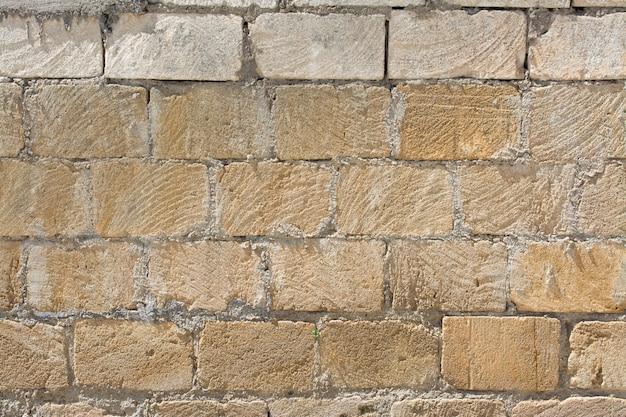 Patroon van afgebroken stenen muur textuur en achtergrond