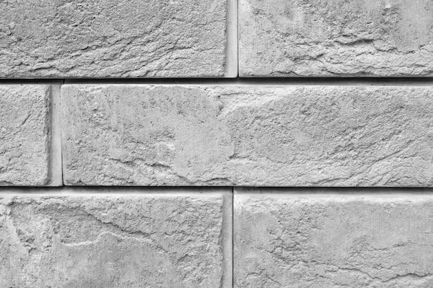 Patroon van decoratieve grijze leisteen stenen muur oppervlak als achtergrond. grijs getint