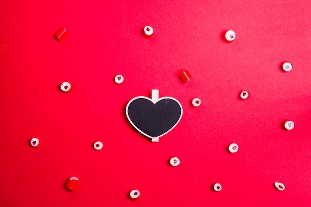 Patroon van hartsuikergoed en hartschoolbord