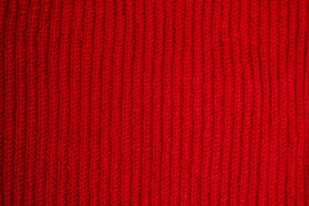 Patroon van kleurrijke gebreide sweatersclose-up. handgemaakt product van merinowol. breipatronen.