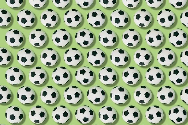 Patroon van voetballen op een groene achtergrond. voetbal en sportconcept