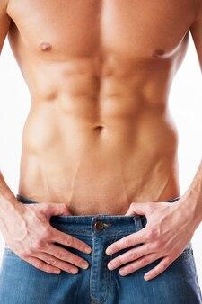 Perfecte torso. close-up, van, jonge, gespierd, man, met, perfect, torso, staand, tegen, witte, background