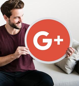 Persoon met een google plus-pictogram