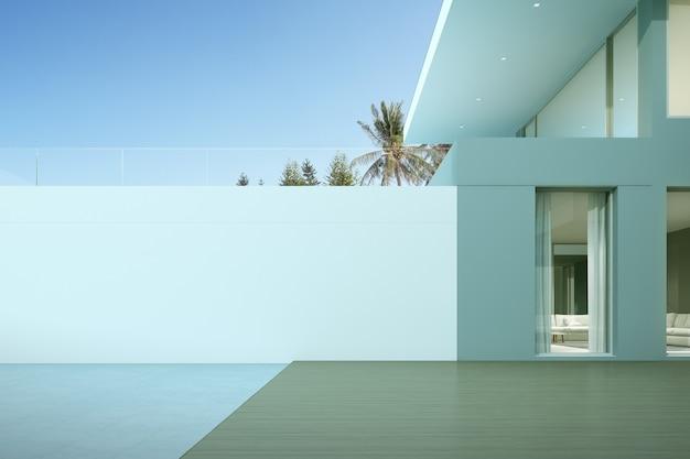 Perspectief van modern luxehuis met houten dek en grote witte muur.
