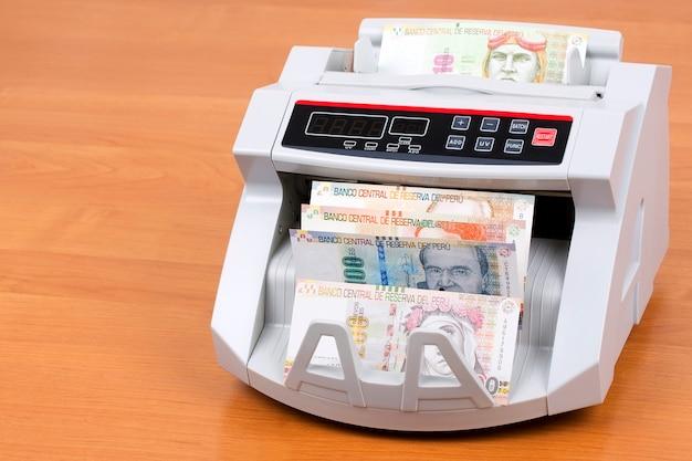 Peruvian sol in een telmachine