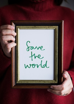 Phrase save the world in een kader