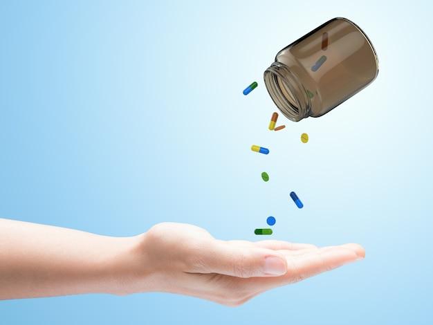 Pillen die uit fles op blauwe achtergrond morsen