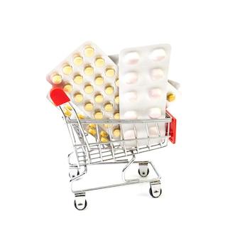 Pillen in een winkelwagentje. gezondheid en geneeskunde concept. online medicijnen kopen.