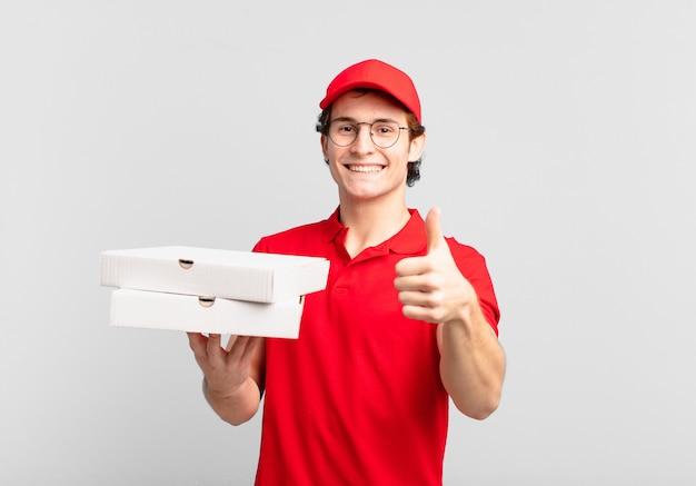 Pizza bezorger voelt zich trots, zorgeloos, zelfverzekerd en gelukkig, positief glimlachend met duimen omhoog