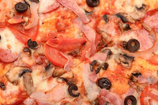 Pizza close-up als achtergrond.