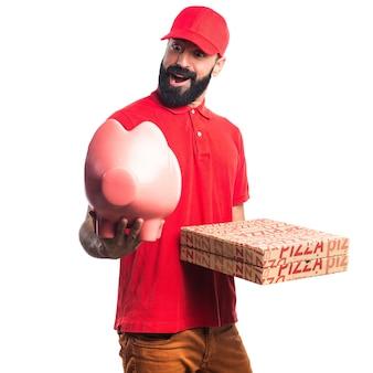 Pizza levering man met een piggybank