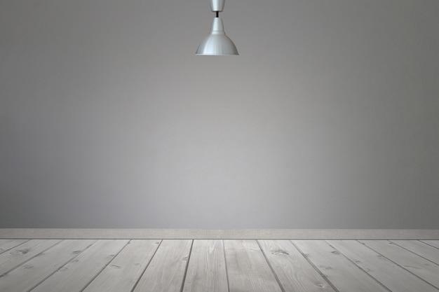 Plafondverlichting in de kamer en licht dat scheen op de muur en op de vloer.