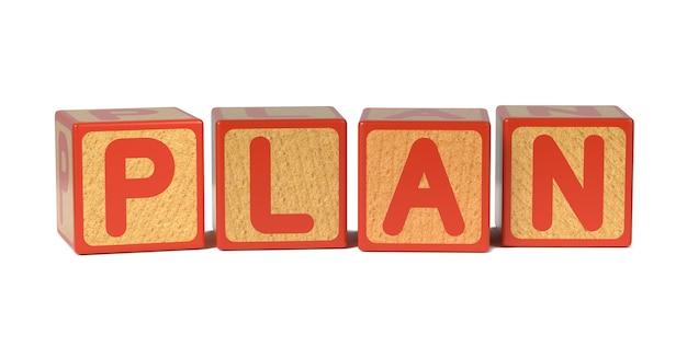 Plan op houten kinderen alfabet blok geïsoleerd op wit.