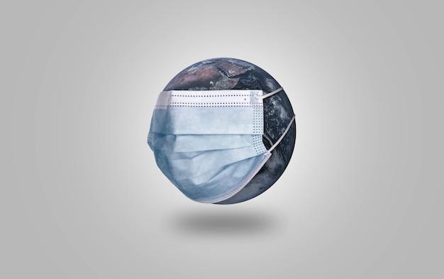 Planeet aarde met medisch beschermend masker, covid-19 pandemie, luchtvervuilingsconcept.