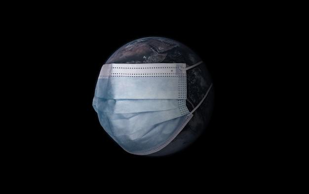 Planeet aarde met medisch masker op een zwarte. milieuvervuiling concept