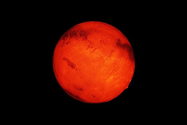 Planeet mars op een donkere achtergrond. elementen van deze afbeelding zijn geleverd door nasa. hoge kwaliteit foto