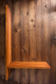 Plank bij houten achtergrondtextuurmuur