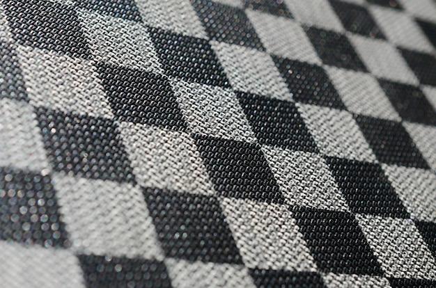 Plastic textuur in de vorm van een zeer kleine stoffen binding, geschilderd in zwart en grijs