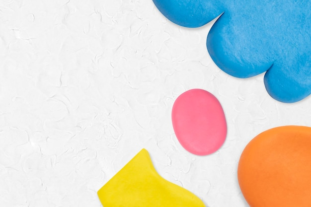Plasticine klei patroon achtergrond in witte kleurrijke rand diy creatieve kunst voor kinderen