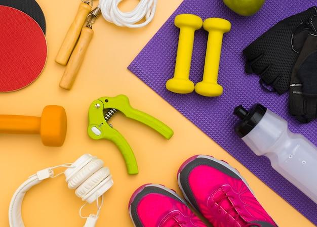Plat handgrijper met koptelefoon en gewichten