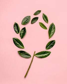 Plat lag arrangement van groene bladeren