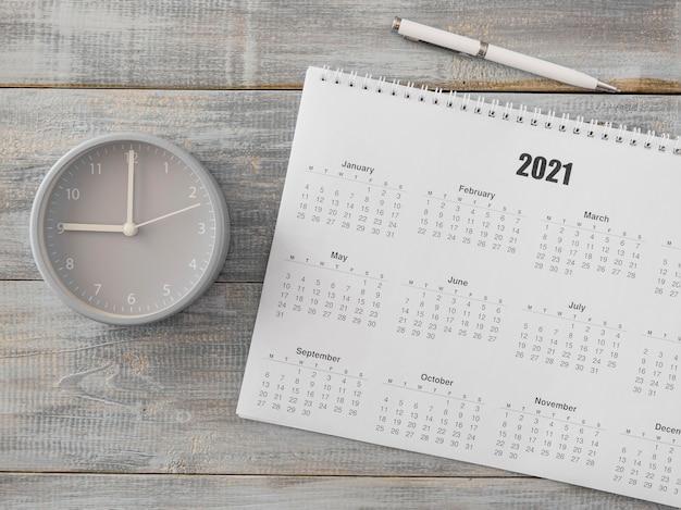 Plat lag bureaukalender en analoge klok