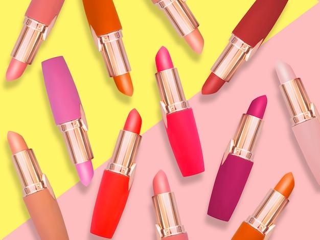Plat leggen mode van lippenstiften op trendy achtergrond. essentieel schoonheidsartikel in roze en gele thema-make-up