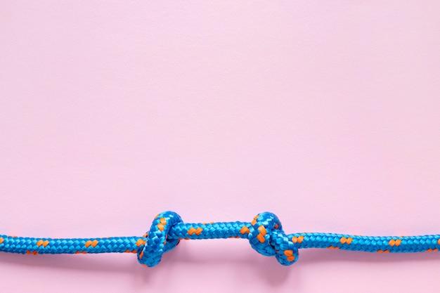 Plat leggen touw met knoop kopie ruimte