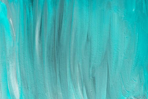 Plat leggen van abstracte blauwe verf penseelstreken op het oppervlak