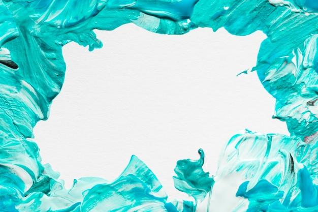 Plat leggen van creatieve verf penseelstreken op oppervlak met kopie ruimte
