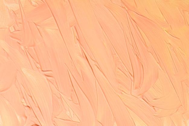 Plat leggen van gele verf penseelstreken op het oppervlak