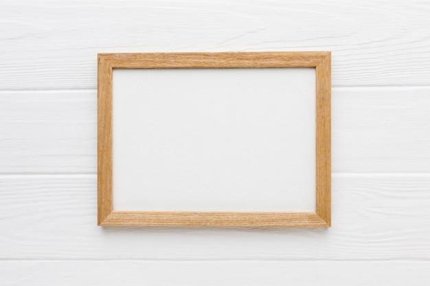 Plat leggen van houten frame met kopie ruimte