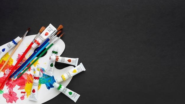 Plat leggen van kleurrijke aquarel met kopie ruimte