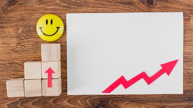 Plat leggen van smileygezicht en groeipijl