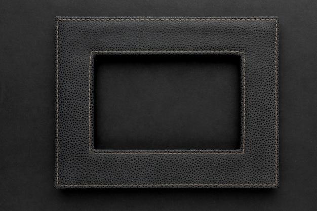 Plat leggen van zwart frame met kopie ruimte