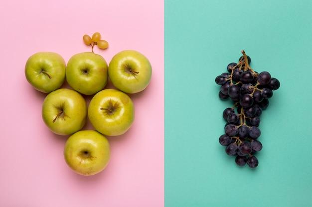 Platliggend druiven- en appelarrangement