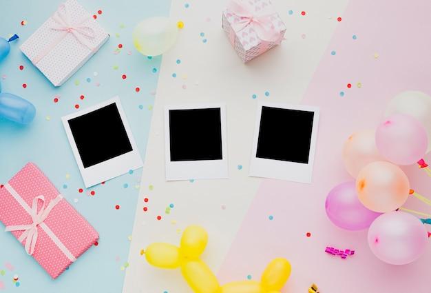 Platliggende decoratie met foto's en ballonnen