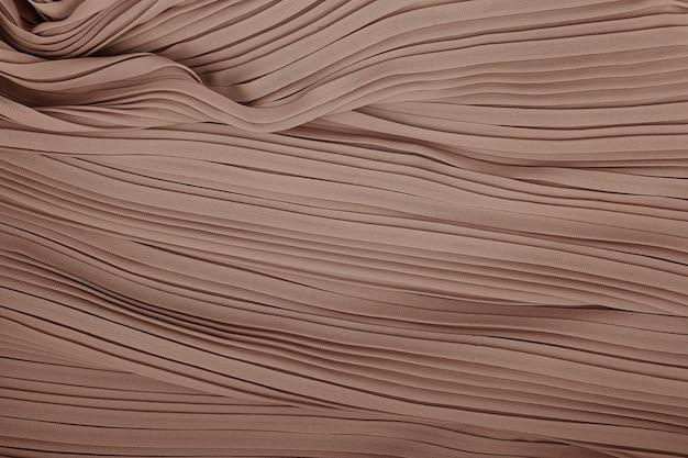 Plissé stof achtergrondstructuur. geplooide rok stof textuur. close-up geplooid stof structuurpatroon
