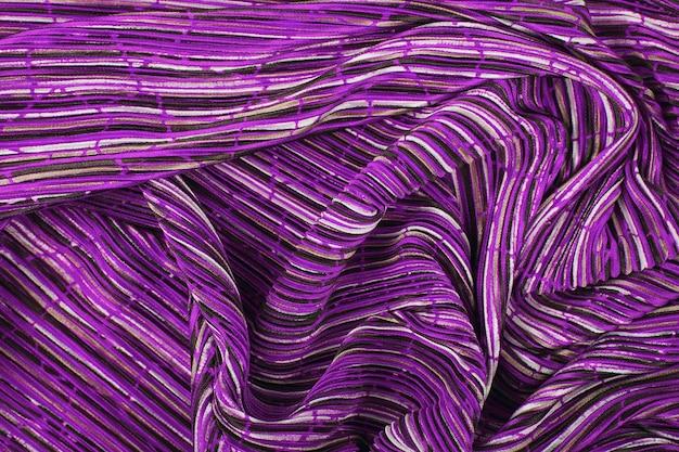 Plissé stof achtergrondstructuur. geplooide stof textuur. close-up geplooid stof structuurpatroon