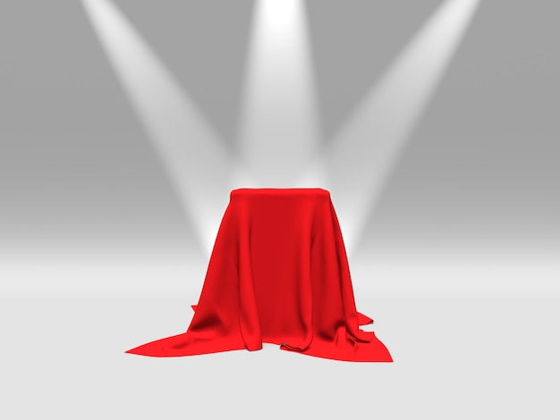 Podium, sokkel of platform bedekt met rode doek verlicht door schijnwerpers op witte achtergrond