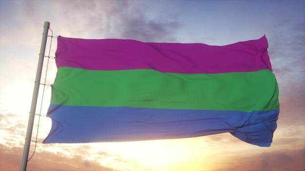 Polyseksualiteit trots vlag zwaaien in de wind, lucht en zon achtergrond. 3d-rendering.