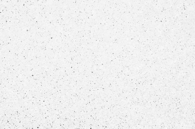Poreuze wit gepleisterde muur