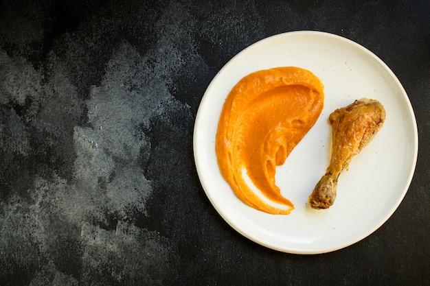 Portie pompoen en kalkoen of kip