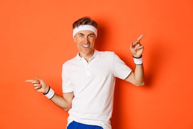 Portret van actieve en gezonde man van middelbare leeftijd in sportkleding, glimlachend tevreden