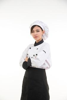 Portret van aziatische jonge donkerbruine chef-kokvrouw