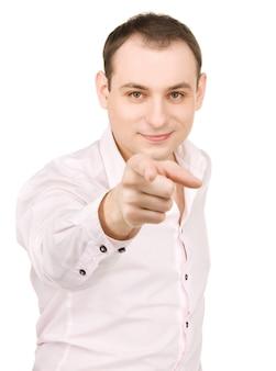Portret van een aantrekkelijke zakenman die met zijn vinger wijst?