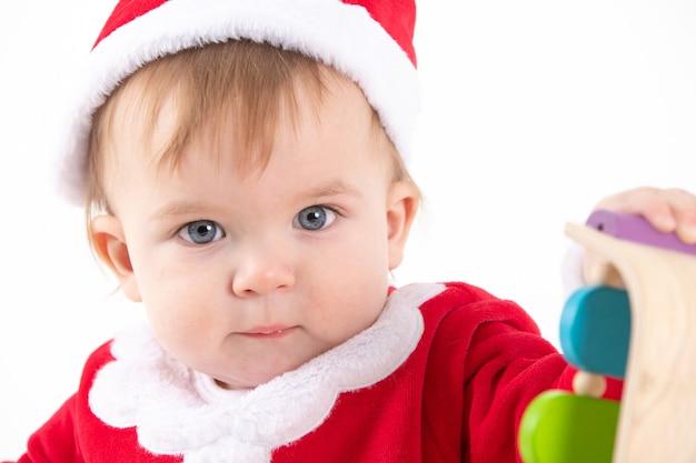 Portret van een baby verkleed als kerstman