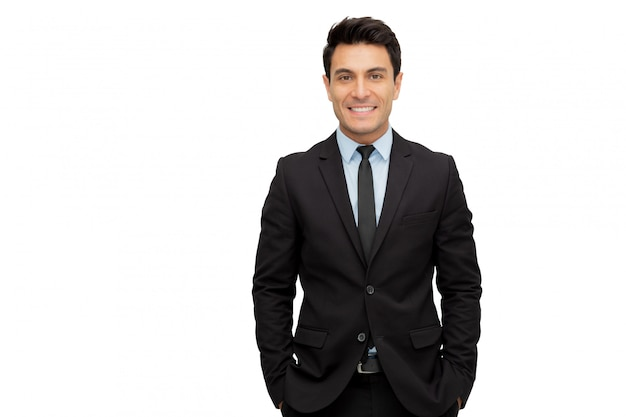 Portret van een charmante zakenman gekleed in pak geïsoleerd op een witte muur