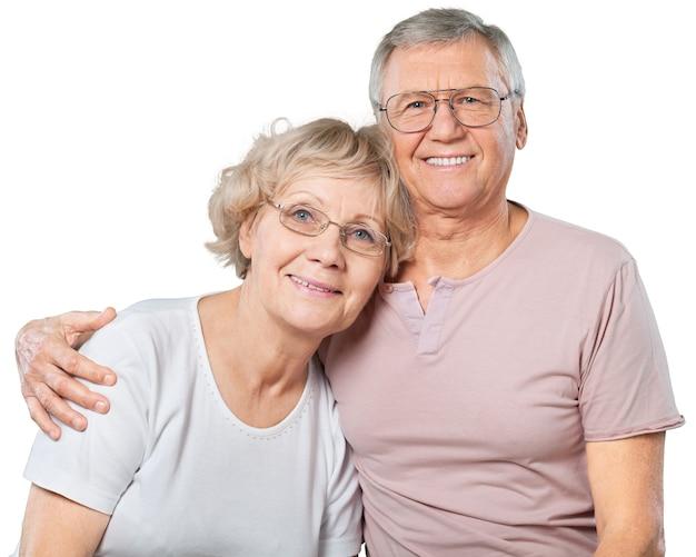 Portret van een gelukkig senior paar dat thuis lacht