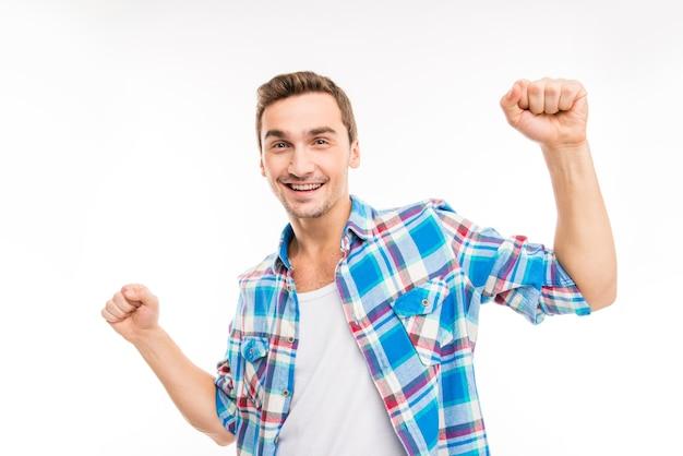 Portret van een gelukkige student, dansen op een witte achtergrond